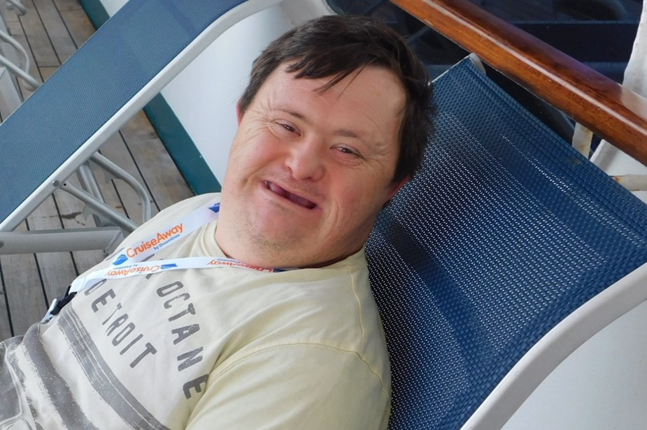 James Spicer reclining on a sun lounge on his Cruise holiday