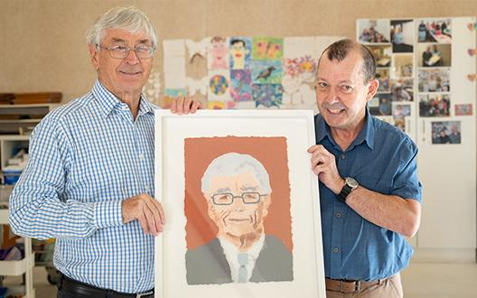 Brett and Dick Smith holding brett's artwork together