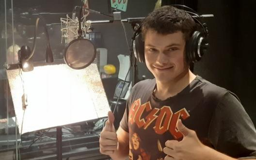 Dylan showing thumbs up in the recording studio