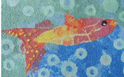 Kim Merrick's paper pulp picture of a colourful salmon swimming upstream